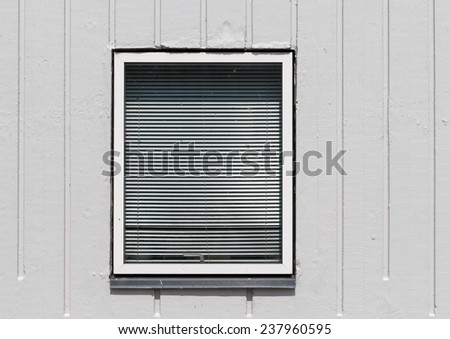 A window in a concrete wall - stock photo