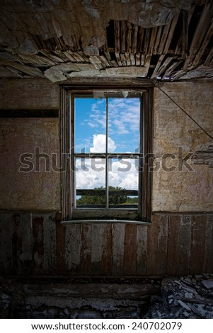 A window in an old ruined house. Clipping path included around window.