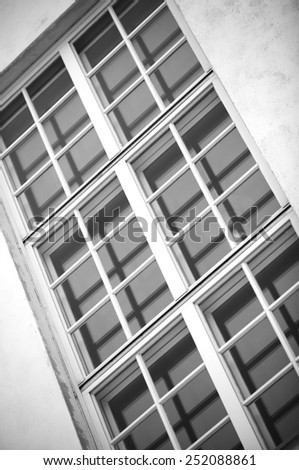 A window in black and white. - stock photo