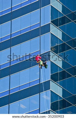 A window washer on a A nice tall office building