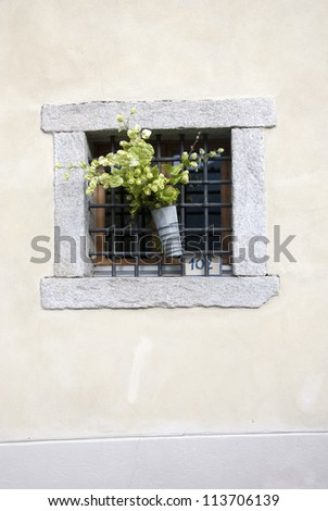 A window with flowers decoration - stock photo