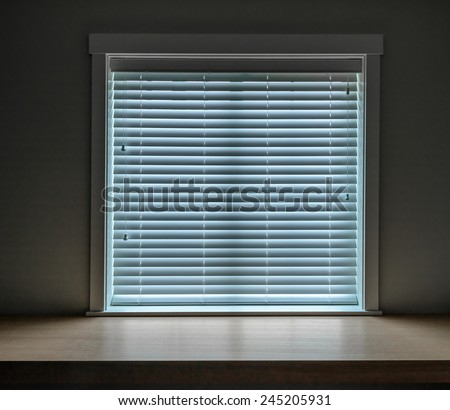 A window with plastic blind. - stock photo