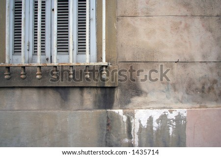 a window with shutter and urban building in marseille, france