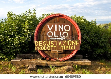 A wine and olive oil tasting sign in Tuscany, Italy. Taste tipical products. - stock photo