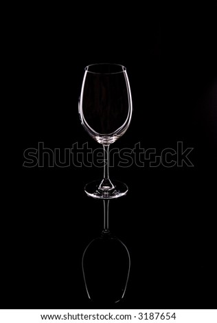 A Wine Glass On A Black Mirror - stock photo