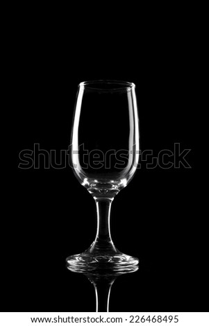 A wine glass reflective bottom isolated black.