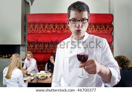 A wine waiter tasting a good glass of wine - stock photo