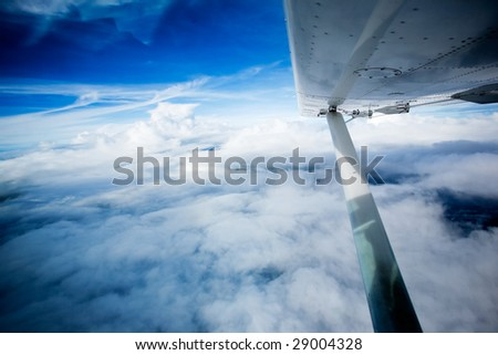 A wing on a small aircraft in flight - stock photo