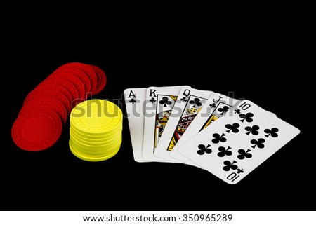 A winning poker hand with chips on black background - stock photo