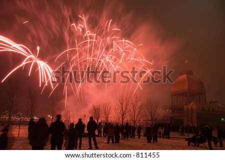 A winter fireworks display in the Old Port of Montreal - some noise at full size - stock photo