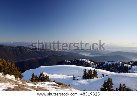 A winter hiking view from the peak of Seymour mountain towards mountain Baker.
