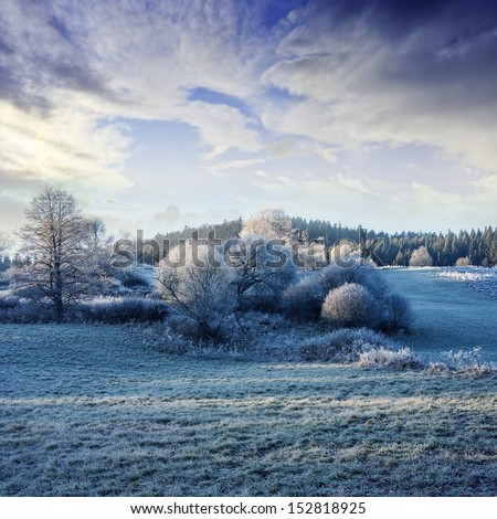 a winter morning with a beautiful sunrise - frozen landscape - stock photo
