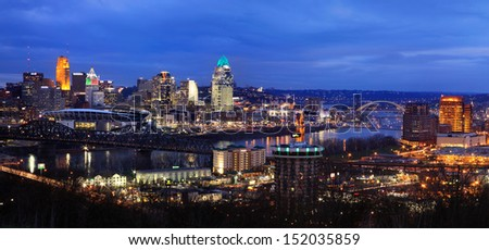 A Winter's Eve After Sunset Along The Ohio River Where It Separates Ohio From Kentucky At Cincinnati, USA - stock photo