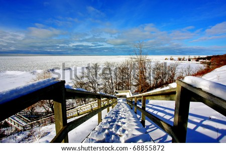 a winter scene by the lake - stock photo