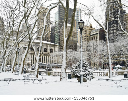 A Winter scene in Bryant Park in Manhattan after an early morning snow. - stock photo