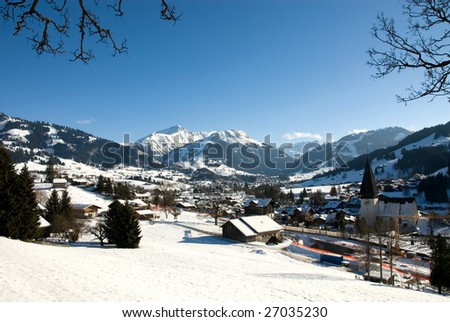 A winter scene in Gstaad, Switzerland - stock photo