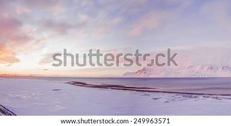 A winter wilderness - midnight sun above sea coast on the island of Spitsbergen, Svalbard, Norway  - stock photo