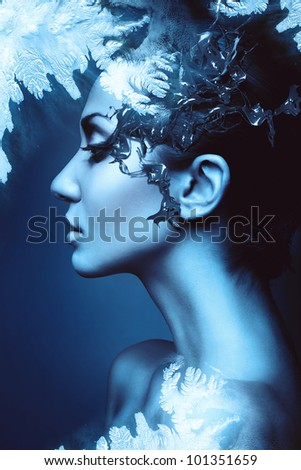 a winter woman head profile with splash - stock photo