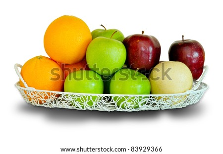 a wire basket full of fresh fruit and vegetables, isolated on a white background. - stock photo
