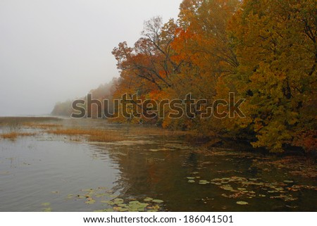 A Wisconsin lake in the autumn fog. - stock photo