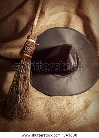A Witch's Broom and Hat. - stock photo