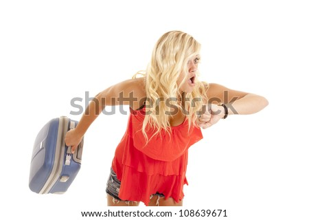 A woman after looking at her watch with a shocked expression on her face because she is late. - stock photo