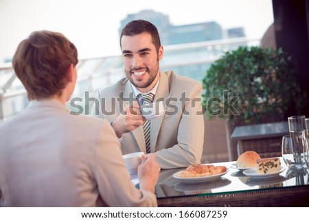 A woman and a man on a business lunch at a restaurant  - stock photo