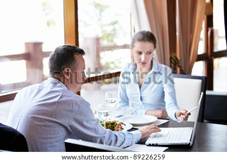 A woman and a man with laptop - stock photo