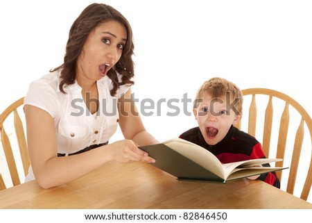A woman and boy shocked at what just happened in the book.