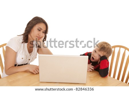 A woman and child both tired of the computer.