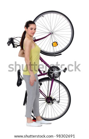 A woman and her big bike. - stock photo