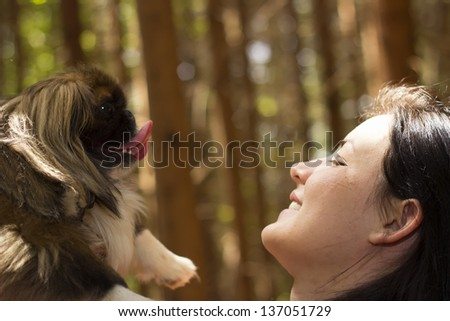 A woman and her dog/Best friends - stock photo