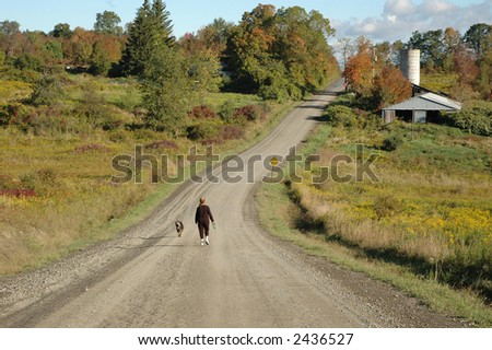 A woman and her dog exercise in the morning - stock photo