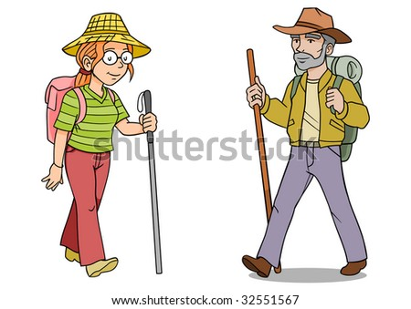 A woman and man hiker with backpacks and walking sticks.
