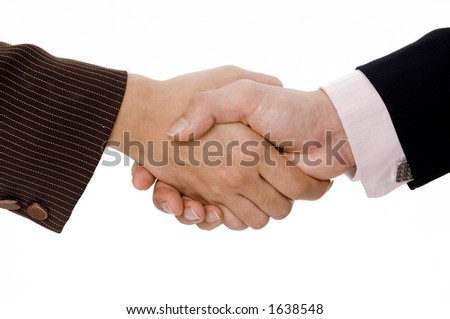 A woman and man shake hands