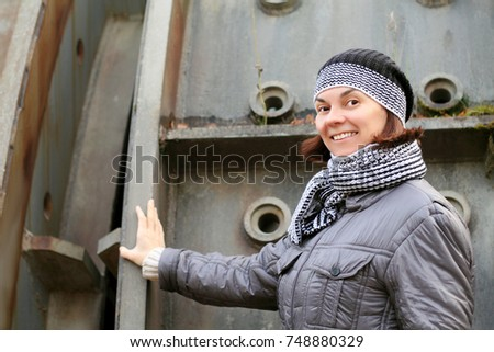 a woman at an old factory