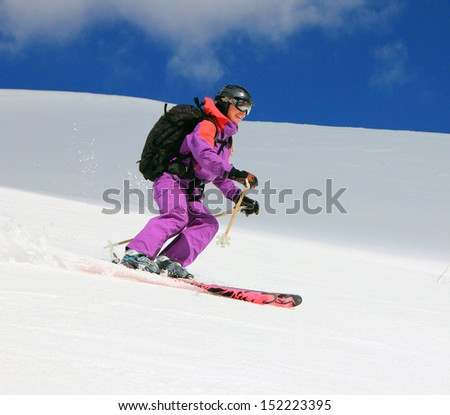 A woman back country skiing in the Utah mountains, USA. - stock photo