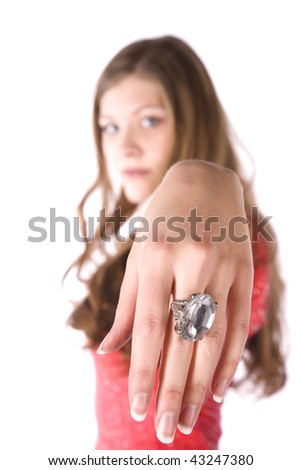 A woman blurred in the background with a big ring on her finger. - stock photo