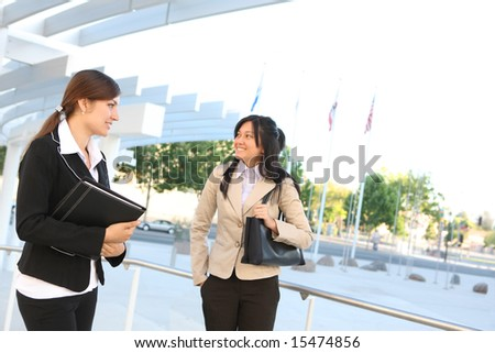 A woman business team at their company office building - stock photo