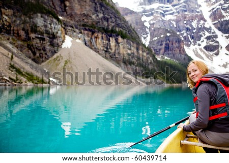A woman canoeing on Moraine Lake, a tight crop with copy space - stock photo