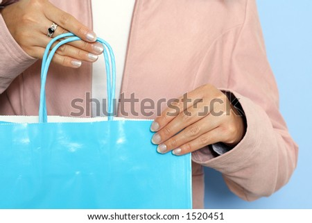 A woman carrying a shopping bag - stock photo