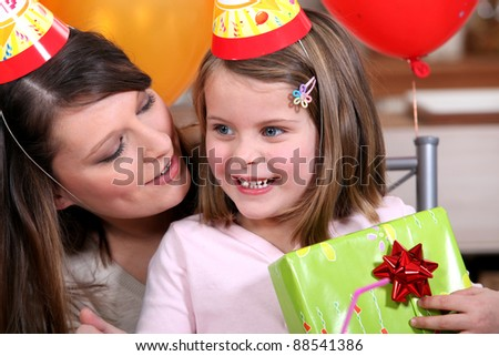 A woman celebrating her daughter's birthday.