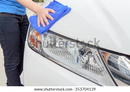 A woman cleaning car with microfiber cloth, car detailing  concept