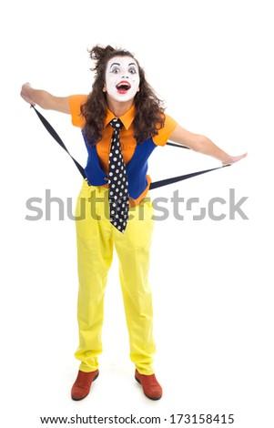 A woman clown shooting in studio - stock photo