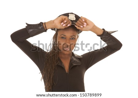 A woman cop up close holding her hat. - stock photo