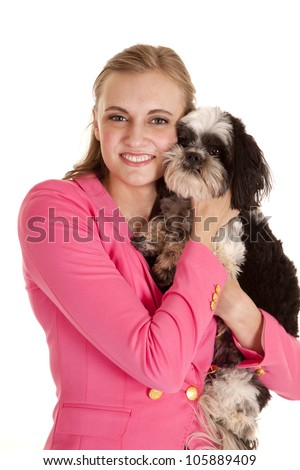 a woman cuddling her dog and snuggling close to his face - stock photo