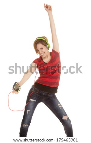 a woman dancing around to her music she is listening to . - stock photo
