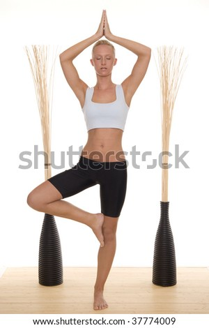 A woman does yoga - stock photo