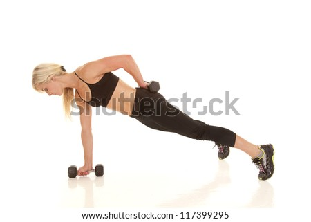 A woman doing  a one arm push up with her weights.
