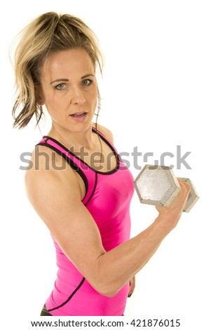 A woman doing an arm curl to build up her bicep. - stock photo
